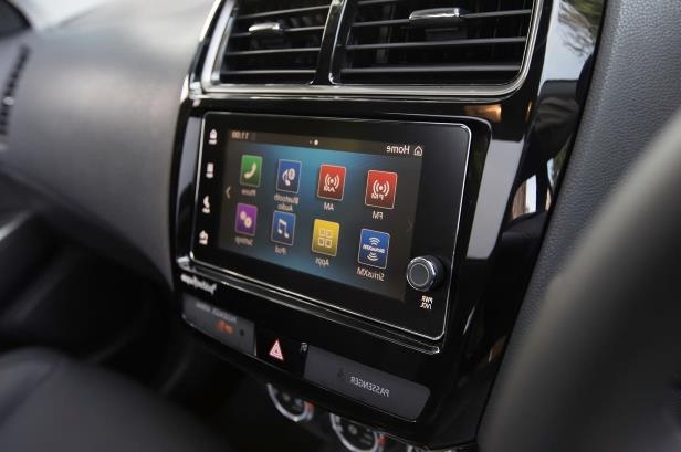 Slide 13 of 20: 2018-Mitsubishi-Outlander-Sport-center-stack-media-screen.jpg