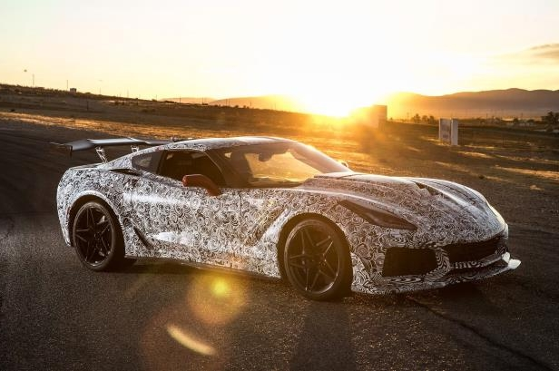 Slide 15 of 68: 2019-Chevrolet-Corvette-ZR1-prototype-front-side-view-with-sun.jpg