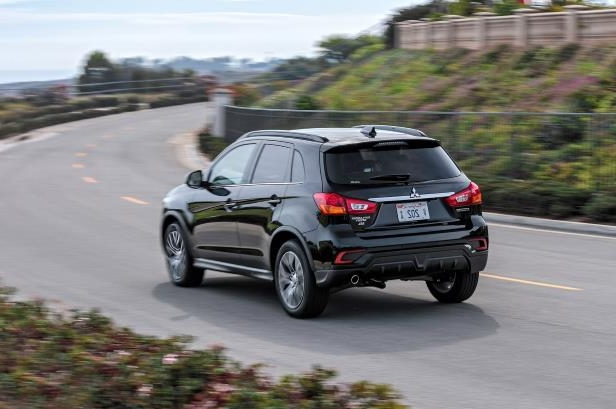 Slide 20 of 20: 2018-Mitsubishi-Outlander-Sport-rear-three-quarter-in-motion-01.jpg