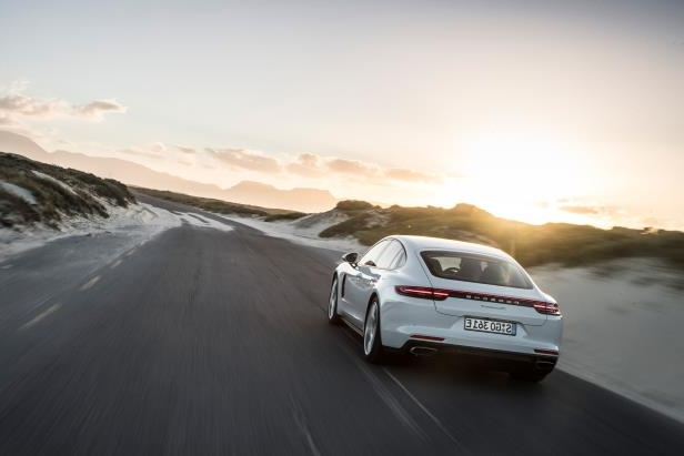 Slide 24 of 93: 2018-Porsche-Panamera-4-E-Hybrid-Rear-Moving.jpg
