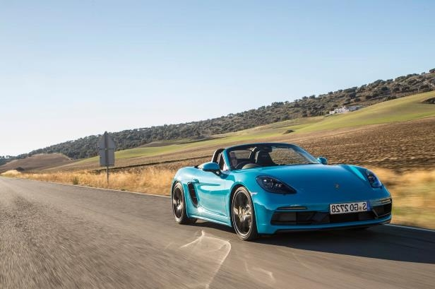 Slide 26 of 104: 2018-Porsche-718-Boxster-GTS-front-three-quarter-in-motion-05.jpg