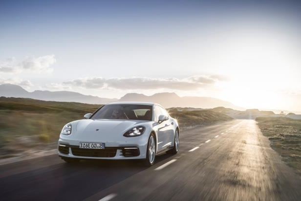 Slide 26 of 93: 2018-Porsche-Panamera-4-E-Hybrid-Moving.jpg