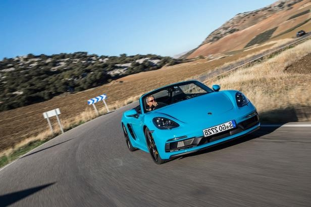 Slide 28 of 104: 2018-Porsche-718-Boxster-GTS-front-three-quarter-in-motion-03.jpg