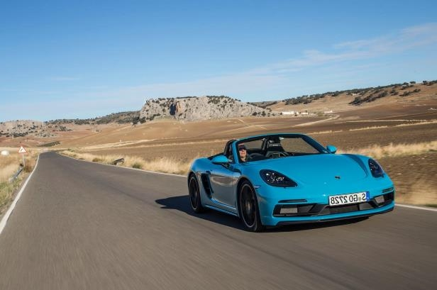 Slide 29 of 104: 2018-Porsche-718-Boxster-GTS-front-three-quarter-in-motion-02.jpg