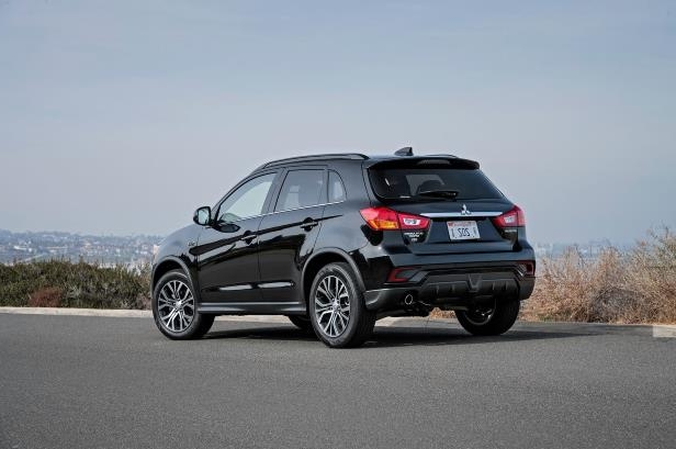 Slide 3 of 20: 2018-Mitsubishi-Outlander-Sport-rear-three-quarter.jpg
