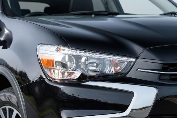 Slide 5 of 20: 2018-Mitsubishi-Outlander-Sport-headlight.jpg