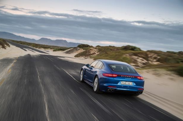 Slide 82 of 93: 2018-Porsche-Panamera-4-E-Hybrid-rear-three-quarter-in-motion-05.jpg