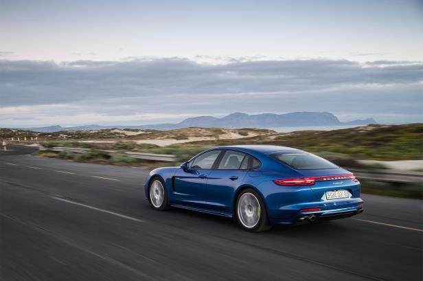 Slide 89 of 93: 2018-Porsche-Panamera-4-E-Hybrid-rear-three-quarter-in-motion-04.jpg