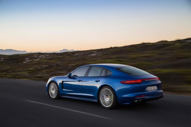 Slide 90 of 93: 2018-Porsche-Panamera-4-E-Hybrid-rear-three-quarter-in-motion-07.jpg