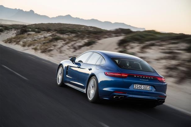 Slide 91 of 93: 2018-Porsche-Panamera-4-E-Hybrid-rear-three-quarter-in-motion-01.jpg
