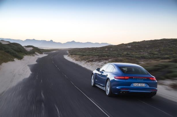 Slide 92 of 93: 2018-Porsche-Panamera-4-E-Hybrid-rear-three-quarter-in-motion-02.jpg