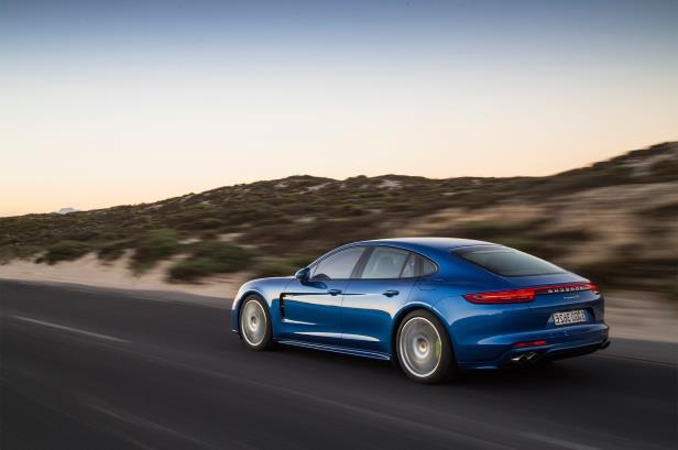 Slide 93 of 93: 2018-Porsche-Panamera-4-E-Hybrid-rear-three-quarter-in-motion-03.jpg
