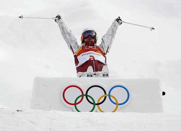 Justine Dufour-Lapointe, of Canada, jumps during the women's moguls qualifying at the 2018 Winter Olympics in Pyeongchang, South Korea, Friday, Feb. 9, 2018. (AP Photo/Gregory Bull)