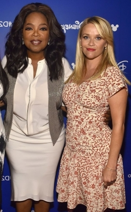 Laura Jean Reese Toth (Witherspoon), Oprah Winfrey posing for the camera: Reese Witherspoon and Oprah Winfrey in July 2017