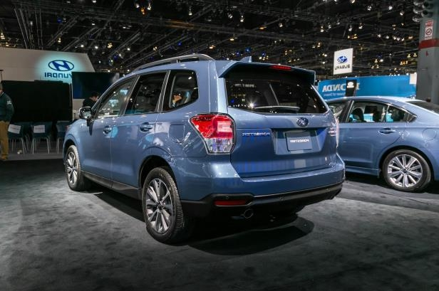 Slide 47 of 70: 2018-Subaru-Forester-50th-Anniversary-Editon-rear-three-quarter.jpg