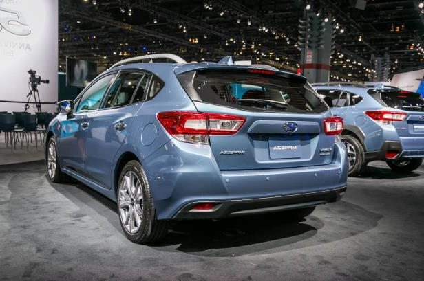 Slide 50 of 70: 2018-Subaru-Impreza-50th-Anniversary-Edition-rear-three-quarter.jpg