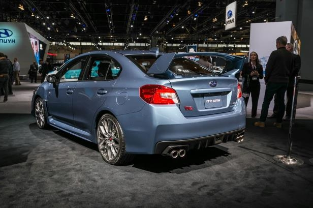 Slide 58 of 70: 2018-Subaru-50th-WRX-STI-rear-three-quarter.jpg