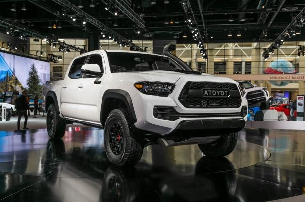 Slide 67 of 70: 2019-Toyota-Tacoma-TRD-Pro-front-three-quarter-02-1.jpg