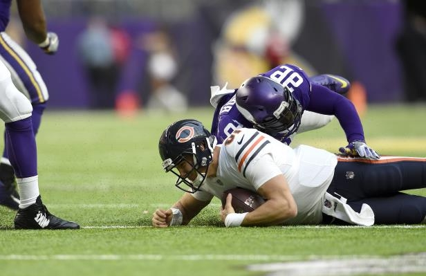MINNEAPOLIS, MN - DECEMBER 31: Brian Robison #96 of the Minnesota Vikings sacks quarterback Mitchell Trubisky #10 of the Chicago Bears in the third quarter of the game on December 31, 2017 at U.S. Bank Stadium in Minneapolis, Minnesota. (Photo by Hannah Foslien/Getty Images)