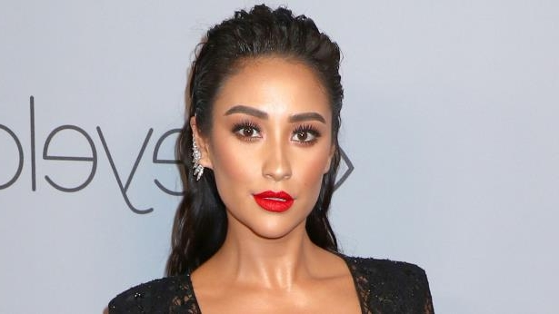 a close up of Shay Mitchell