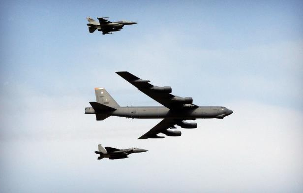 FILE - In this Jan. 10, 2016, file photo, a U.S. Air Force B-52 bomber flies over Osan Air Base in Pyeongtaek, South Korea. The Air Force says the venerable B-52 bomber, which gained lasting fame in Vietnam as an aerial terror, is now likely to outlive its younger, far snazzier brother bombers, the swept-wing B-1 and the stealthy B-2. (AP Photo/Ahn Young-joon, File)