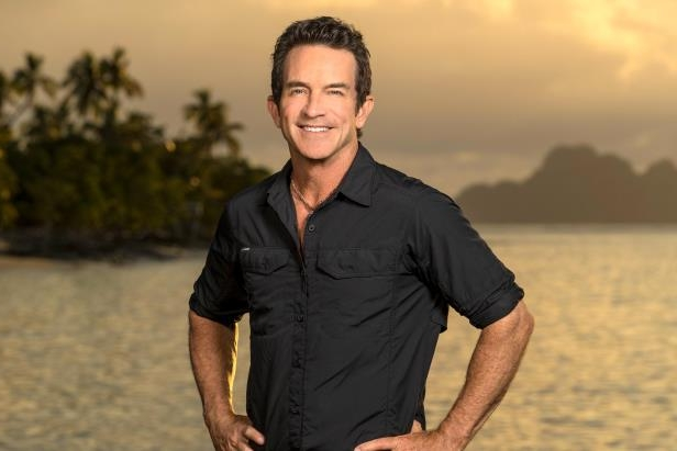 Jeff Probst standing in front of a body of water