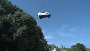 RAW: Crane lifts vehicle after woman reverses off cliff