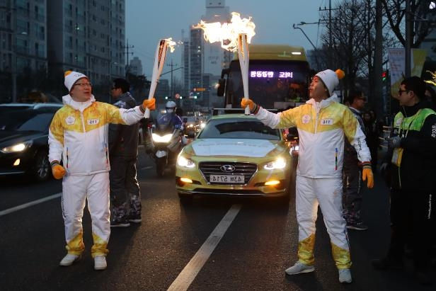 Slide 120 of 121: Torch bearers pose with the PyeongChang 2018 Winter Olympics torch during the PyeongChang 2018 Winter Olympic Games torch relay on Jan. 16, 2018 in Seoul, South Korea.