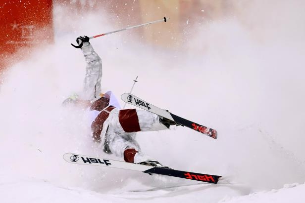 Slide 26 of 133: PYEONGCHANG-GUN, SOUTH KOREA - FEBRUARY 12:  Philippe Marquis of Canada crashes in the Freestyle Skiing Men's Moguls Final on day three of the PyeongChang 2018 Winter Olympic Games at Phoenix Snow Park on February 12, 2018 in Pyeongchang-gun, South Korea.  (Photo by Clive Rose/Getty Images)