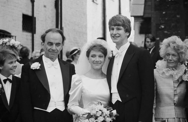 Slide 4 of 28: Newspaper proprietor Rupert Murdoch, right, with his daughter Prudence, 26, center, and new son-in-law Crispin Odey, when the couple were married at St. Michaels Church, Chester Square in London, May 24, 1985. Crispin, the only son of Mr. and Mrs. Richard Odey of Hotham Hall, Yorkshire, is an insurance broker. The rest of the group is unidentified.