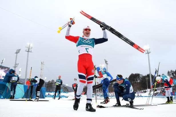 Slide 47 of 121: PYEONGCHANG-GUN, SOUTH KOREA - FEBRUARY 11:  Simen Hegstad Krueger of Norway celebrates winning the gold medal during the Men's 15km and 15km Skiathlon Cross-Country Skiing on day two of the PyeongChang 2018 Winter Olympic Games at Alpensia Cross-Country Centre on February 11, 2018 in Pyeongchang-gun, South Korea.  (Photo by Matthias Hangst/Getty Images)