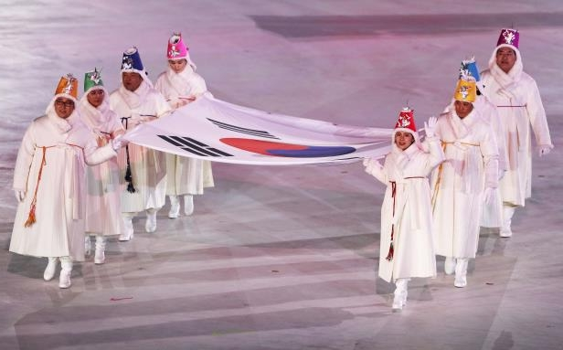 Slide 84 of 121: PYEONGCHANG-GUN, SOUTH KOREA - FEBRUARY 09: The South Korean flag is carried into the stadium during the Opening Ceremony of the PyeongChang 2018 Winter Olympic Games at PyeongChang Olympic Stadium on February 9, 2018 in Pyeongchang-gun, South Korea. (Photo by Jamie Squire/Getty Images)