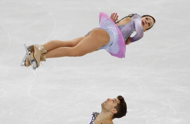 Slide 93 of 121: Figure Skating – Pyeongchang 2018 Winter Olympics – Team Event Pair Skating short program – Gangneung Ice Arena - Gangneung, South Korea – February 9, 2018 -  Nicole Della Monica and Matteo Guarise of Italy compete. REUTERS/Damir Sagolj     TPX IMAGES OF THE DAY - RC11D523A630