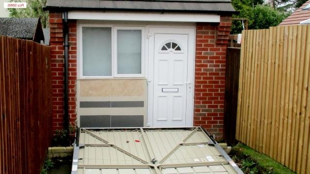 The couple used a fake garage door to hide the secret home. Pic: SWNS