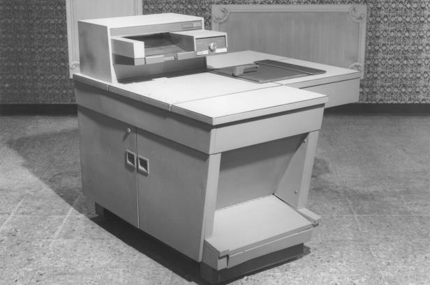 a box on a table: Father of them all: The Xerox 914 copier, introduced in 1960, was the most successful industrial product in history. But its dominance didn't last.