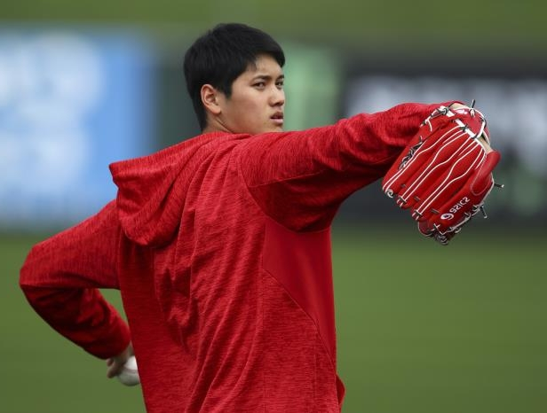 Los Angeles Angels' Shohei Ohtani throws during a spring training practice on Tuesday, Feb. 13, 2018, in Tempe, Ariz.