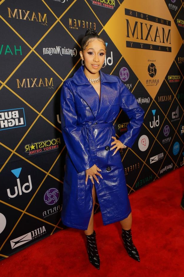 a person standing posing for the camera: Cardi B attends the 2018 MAXIM party produced By Karma International in Minneapolis, Minnesota, on Feb. 3, 2018.