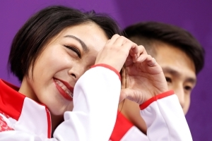 The Latest: Olympic pairs free skate underway; China in 1st