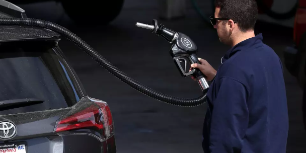 In this file photo, a customer prepares to pump gasoline into his car at a gas station on May 10, 2017 in San Anselmo, California. If you ever put the wrong type of fuel into your car, there are a handful of measures to ensure no serious damage is caused.