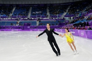 The Latest: Crowd sparse as Olympic ice dancing begins