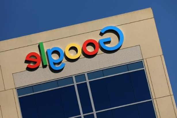 a close up of a sign: FILE PHOTO: Google logo on office building in Irvine, California