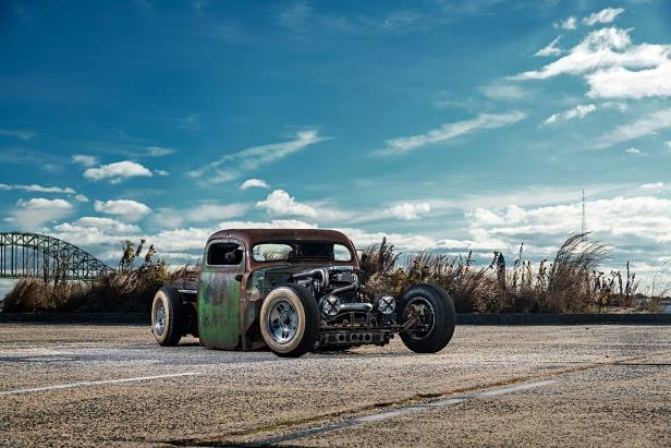 a car parked in a dirt field: 1949 Ford F3 Pickup Rat Rod