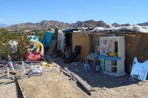 Couple arrested after 3 kids found living in filthy desert shack