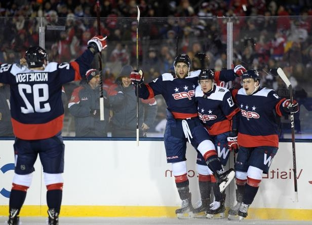 Washington Capitals left wing Jakub Vrana (13), of Czech Republic, celebrates his goal with right wing Tom Wilson (43) and defenseman Dmitry Orlov (9), of Russia, and center Evgeny Kuznetsov (92) of Russia, during the second period of an NHL hockey game against the Toronto Maple Leafs, Saturday, March 3, 2018, in Annapolis, Md. (AP Photo/Nick Wass)