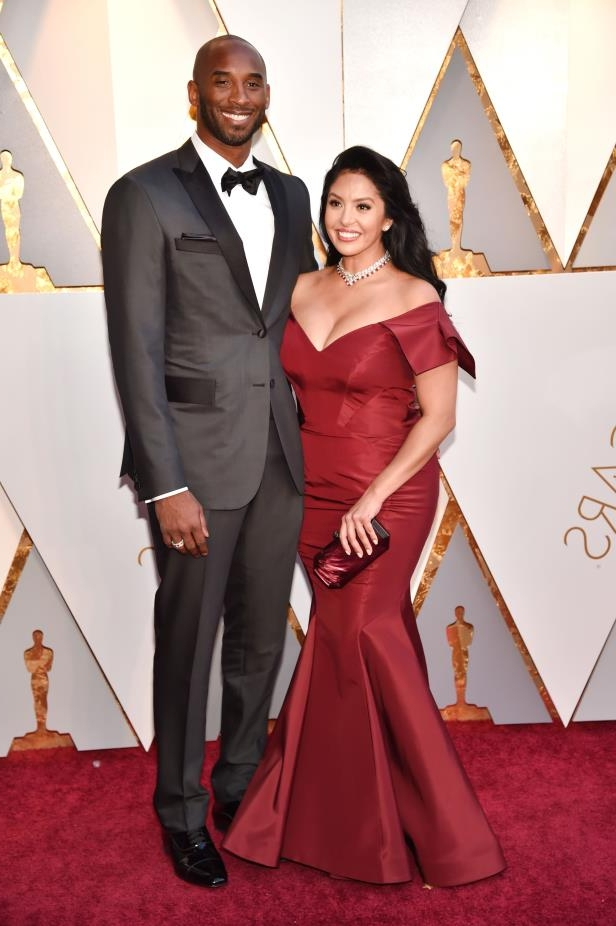 Kobe Bryant and woman posing for a picture: Vanessa Laine Bryant and Kobe Bryant attend the 90th Annual Academy Awards in Hollywood on March 4, 2018.