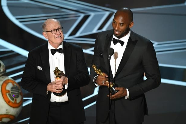 Kobe Bryant, Glen Keane are posing for a picture: Kobe Bryant and Glen Keane accept Best Animated Short Film for 'Dear Basketball' onstage during the 90th Annual Academy Awards at the Dolby Theatre at Hollywood & Highland Center in Hollywood, California on March 4, 2018.
