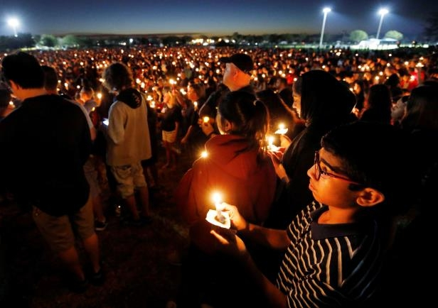People attend a candlelight vigil the day after a shooting at Marjory Stoneman Douglas High School in Parkland, Florida, U.S. February 15, 2018