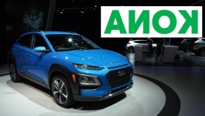 a blue sign in front of a car: 2017 LA Auto Show: 2018 Hyundai Kona