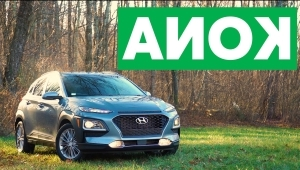 a car parked in front of a sign: 2018 Hyundai Kona Quick Drive