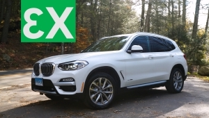 a car parked on the side of a road: 2018 BMW X3 Quick Drive